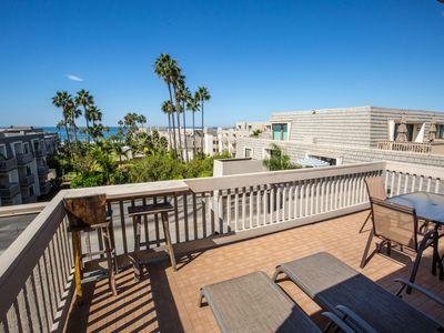 Photo for Rare West-facing Penthouse Unit with Ocean View & 2 Pkg Spaces!