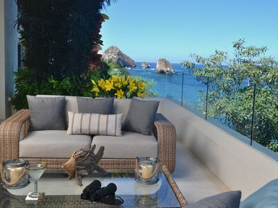 Photo for Exclusive ocean front condo with amazing views to Los Arcos and city