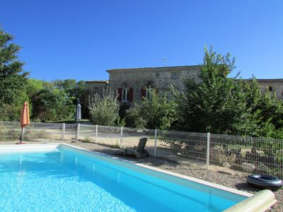 Photo for Homerez last minute deal - Amazing house with pool access