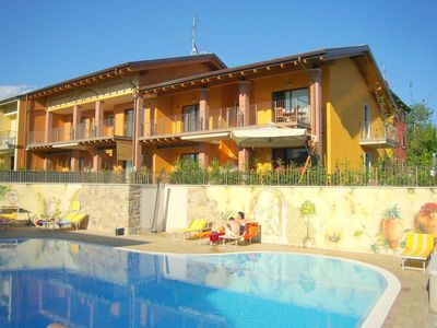 Photo for Apartment with pool, near Lake Garda