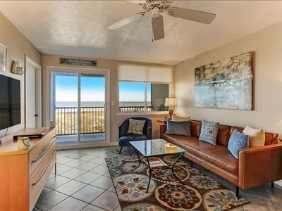 Photo for This renovated two bedroom one bath oceanfront condo is bright and airy and fully furnished with everything that you need for your island getaway including Comcast cable, a DVD player and free High speed internet access.