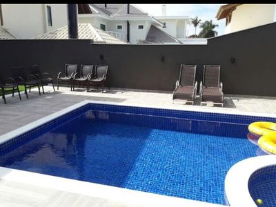 Photo for Modern house for 10 people in Jurerê international 250 m from the beach