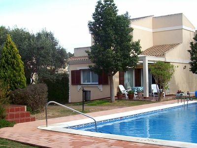 Photo for Community Villa With Communal Outdoor Heated Pool