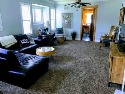 The living room with lots of seating and a Smart TV.