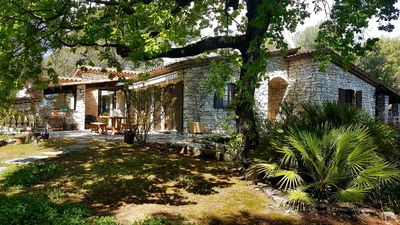 Photo for Beautiful stone bastide for 8 people with Mediterranean garden and pool