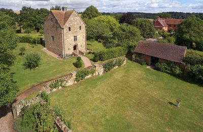 Photo for The Dovecote, in the grounds of Elizabethan Pauntley Court, is the perfect country escape.