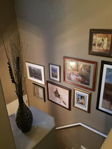 The entryway features an assortment of eye-catching prints.