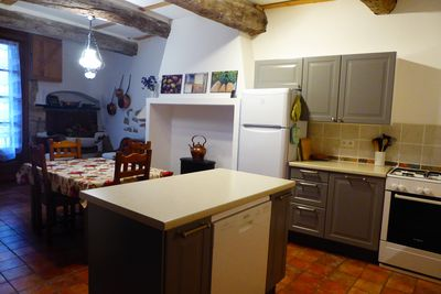 Kitchen with dining table to the left