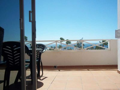 Photo for Apartment TABIZ in Puerto del Carmen for 4 persons with shared pool, terrace, garden, balcony, views to the ocean, WIFI and less than 200m to the sea