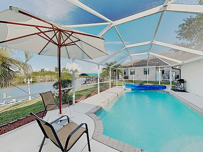 Photo for New Listing! Boater's Bliss: Home on Canal w/ Gulf-Access Dock, Pool & Lanai