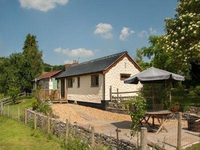 Photo for Holiday home in the woods with solar panels and a spacious garden