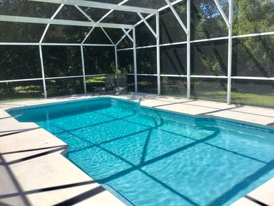 Over sized rectangular  pool - full screened, electric heat available.
