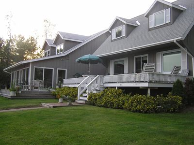 Photo for Beautiful lakeshore home on 10+ landscaped acres