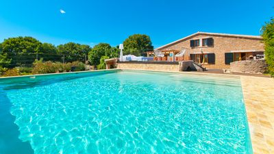 Photo for Design villa with outdoor jacuzzi, gardens, swimming pool, 150 m from the beach, Wifi