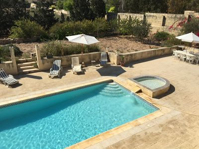 Photo for Farmhouse overlooking the sea and valley with large private pool