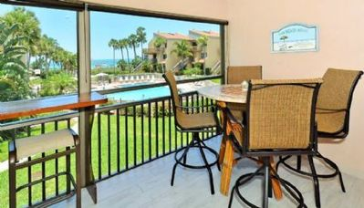 Photo for Chinaberry 423 - 2 Bedroom Condo with Private Beach with lounge chairs & umbrella provided, 2 Pools, Fitness Center and Tennis Courts.