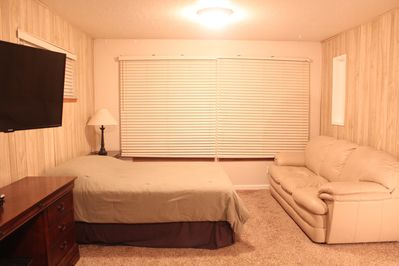 Other side of Upstairs Master Suite with Full Bed, couch and wall mounted LCD TV