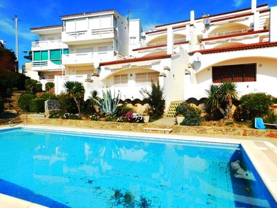 Photo for Apartment with large sea view terrace and pool in Puig Rom, Roses