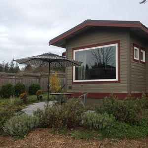 Photo for Peaceful waterfront cottage, close to town!