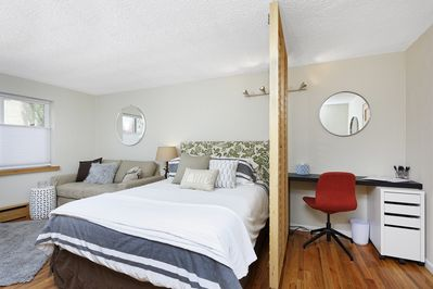 Cozy newly furnished studio with desk area.
