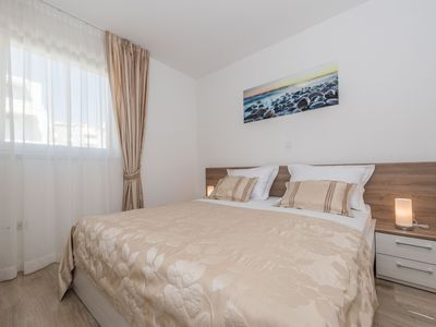 Photo for Deluxe Two-Bedroom App with Terrace and Sea View