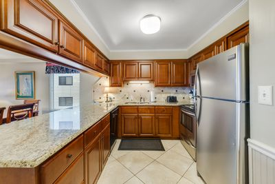 WELL STOCKED KITCHEN FOR THOSE WANTING TO COOK IN. SPACIOUS KITCHEN.