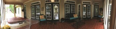 Screened in porch with 7 person spa that overlooks water.