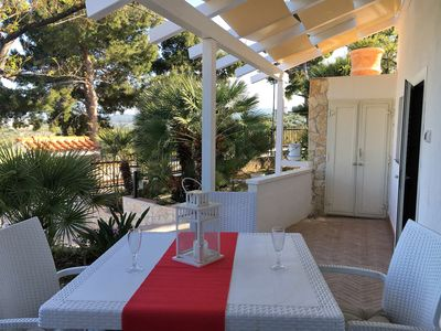 Photo for Enchanting villa with breathtaking views a stone's throw from the sea with int parking