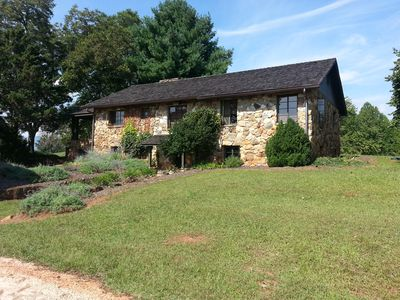 Photo for Stone cottage 2 miles from Tryon Equestrian Center, vineyard and mountain views