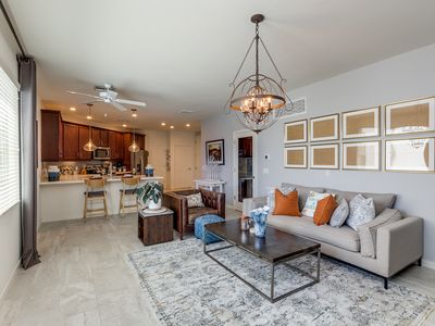 """Photo for Pool View Luxury Condo with Private Office and 75"""" TV! 30 Night Minimum!"""
