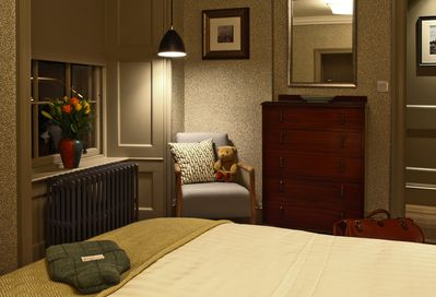 Bedroom:  tastefully furnished, a peaceful refuge insulates you from all around.