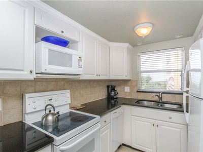 Photo for #222 Surf Song Resort: 2 BR / 2 BA phase i in Madeira Beach, Sleeps 4