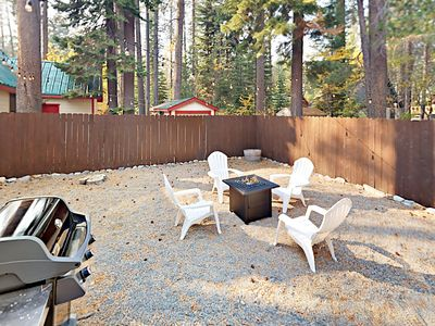 Backyard - The private backyard has a fire pit and a cookout-ready gas grill.