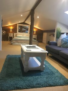 Mezzanine  bedroom with tv sofa and game consoles