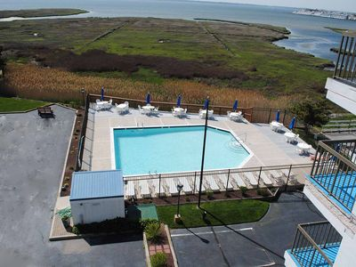 Photo for Traditional 2 Bedroom Condo with Free WiFi, an Outdoor Pool, and Stunning View of Marshes and Bay Located in Midtown and Only a Block and a Half from the Beach!
