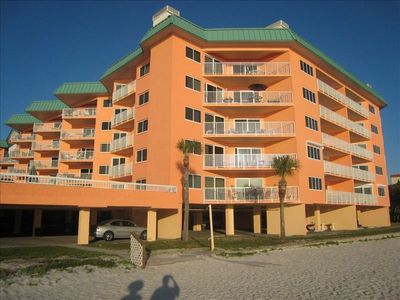 Right on the beach!  Our condo is the 2nd floor corner unit.  Great views!