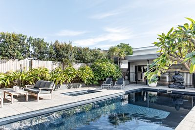 The backyard feels like your own private resort.