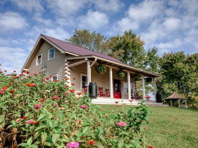 Photo for French Broad Cabin: private hiking, covered porch, fire-pit, downtown Marshall & 70 Mile VIEWS!