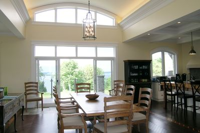 Dining room seats 10, all with arm chairs, walk out to deck, great views