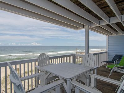 Photo for Escape to this updated oceanfront condo with long coastline views