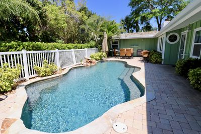 Soothing waterfall & tropical heated saltwater pool shared with attached 2 BR
