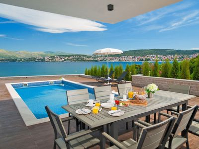 Photo for This 6-bedroom villa for up to 11 guests is located in Okrug Gornji and has a private swimming pool,