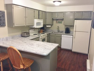 Full kitchen with granite counter tops.
