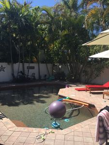 Photo for Cozy historic bungalow w/ salt water pool very close to D.T