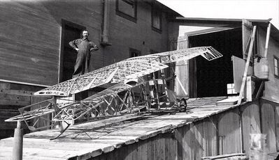 Jacob Sellmer with one of his flying machines on the ramp leading up to the barn