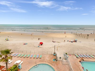 Photo for Ocean front condo with private balcony, shared pool, kiddie pool, and free WiFi!
