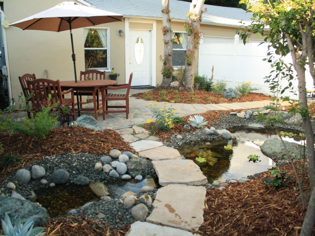 Peaceful streams cottage a cozy restful spot in the for Virtual koi fish pond