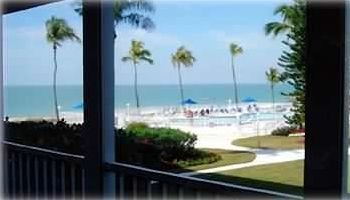 View from the enclosed porch, overlooking the pool area and the Gulf of Mexico