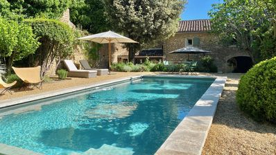 Photo for Stylish 18th century stone house with pool in quiet Gordes hamlet