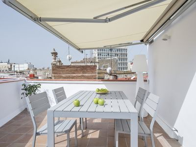 Photo for Bright and modern apartment with terrace in the city center